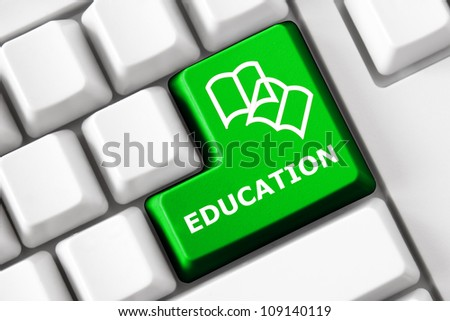Keyboard with Education text and book symbols