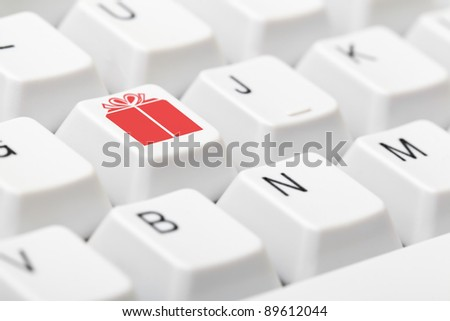 Keyboard with gift symbol key - online christmas present shopping concept