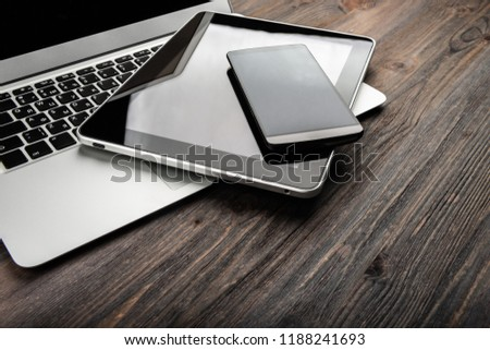 keyboard with phone and tablet pc on wooden desk #1188241693