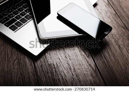 keyboard with phone and tablet pc on wooden desk  - Shutterstock ID 270830714