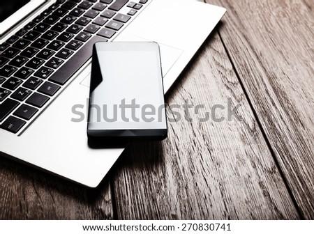 keyboard with phone on wooden desk  - Shutterstock ID 270830741
