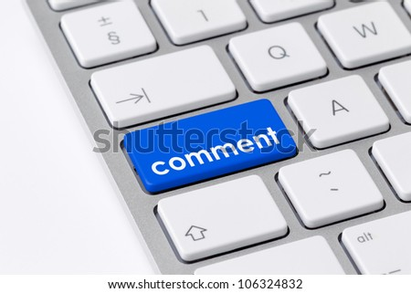 Keyboard with single blue button showing the word comment