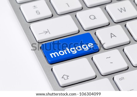 Keyboard with single blue button showing the word mortgage
