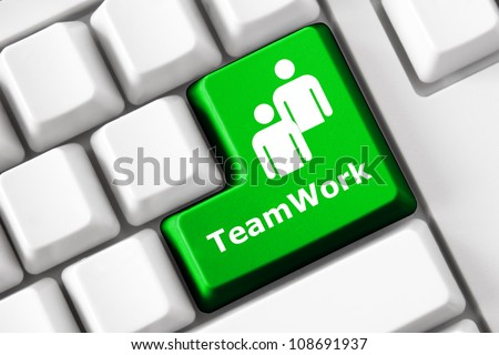 Keyboard with Teamwork text and people symbol
