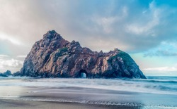 Keyhole rock of Pfeiffer Beach in Big sur California - Long Exposure - Clouds and Blue sky in background