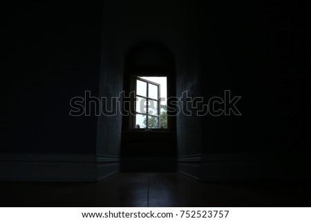 Keyhole window in an empty room #752523757