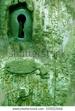 keyhole with number, green door