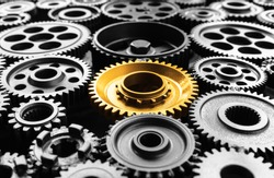 Keyman,key success or leadership concepts with metal gold cog outstanding in another cogs.Business performance.teamwork of human.