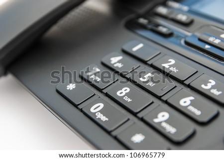 keypad of a black telephone