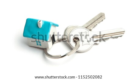 Keys and house key ring isolated on white background. Concept of buying a house, renting, mortgage, gift