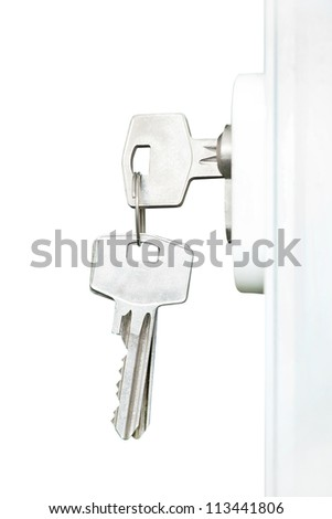 Keys in door lock, isolated on white