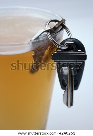 Keys in glass of beer