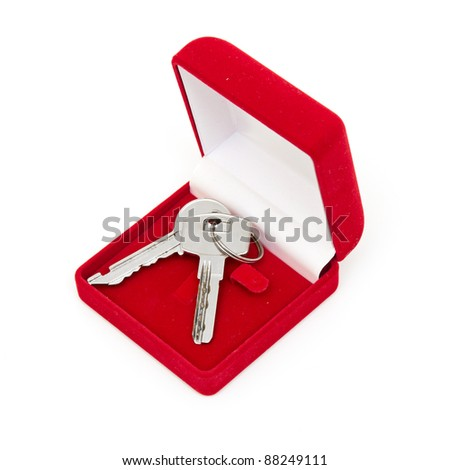keys in red gift box isolated on white