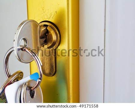 keys in the lock of a modern door mortgage concept