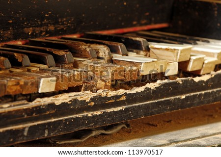 keys of an old piano damaged by time