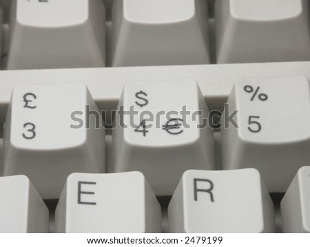 Keys of computer keyboard with dollar Euro and pound symbols - horizontal composition