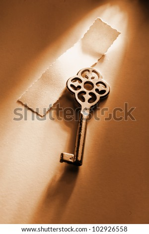 keys of to conceptual things in dramatic lighting - stock photo