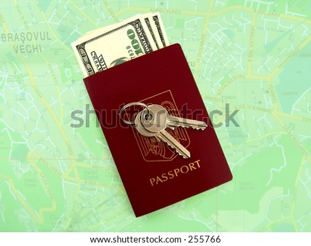keys, passport and dollars, green map in the background