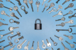 Keys set and lock concept, blue background. Protection of business and home, real estate security concept. Different antique and new keys.