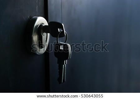 Keys stuck in a lock in vintage style