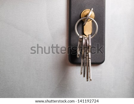 Keys stuck in a lock. The photo shows a macro detail