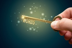 Keywords are a key for successful SEO concept. Unlock potential of your web with optimized keywords. Hand with key with text keywords.