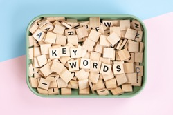 Keywords search concept. Beautiful Top view close up - A pile of wooden alphabet letters  arranging word