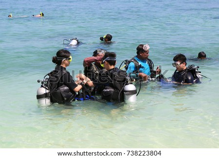 KHAI NAI ISLAND,PHUKET,THAILAND-APRIL 3:Asian Tourist Group learning how to snorkel  at  Khai nai island.April 3,2016 in Phuket,Thailand.  #738223804