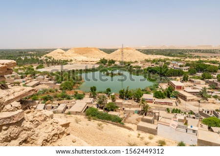 Khairpur Kot Diji Fort with Picturesque Breathtaking View of Landscape with Pond on a Sunny Blue Sky Day Zdjęcia stock ©