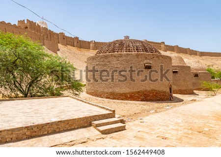 Khairpur Kot Diji Fort with Picturesque View of Round Shaped Silos Buildings on a Sunny Blue Sky Day Zdjęcia stock ©