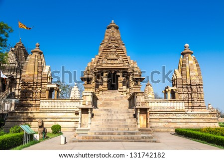 KHAJURAHO, INDIA - APRIL 17: Temples of Khajuraho, one of the most popular tourist destinations in India, famous for erotic sculptures on April 17, 2012 in Khajuraho, India. Unesco World Heritage.