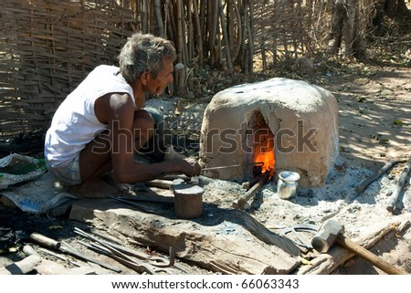 KHAJURAHO, INDIA - 15 FEBRUARY: Indian black smith craftsman works with steel in traditional, ancient way, on February 15, 2008 in Khajuraho, Madhya Pradesh, India.