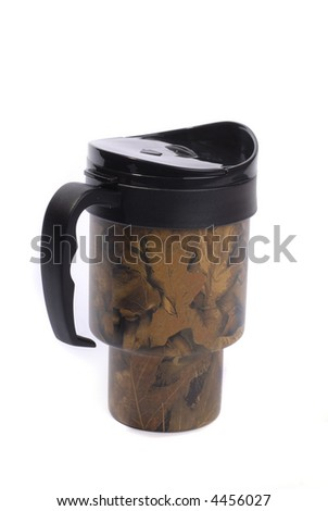 Khaki coloured cup with cap for drinking hot drincs such as coffee or tee for camping