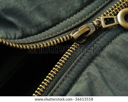 khaki jacket fragment with metal zipper