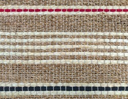 khaki weave burlap texture background with red/ blue cotton rope decoration