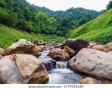 Khao Chong Lom Waterfall Flows in the fresh green valley.Touchable nature  At Khun Dan Prakarnchon Dam, Nakhon Nayok Province, Thailand. Stock fotó ©