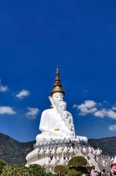 Khao Kho, Phetchabun, Thailand - December 2020: Tourists are traveling and taking pictures at Wat Pha Sorn Kaew or Phra That Pha Kaew, a famous beautiful temple in Thailand.