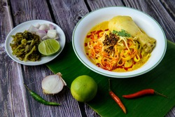 Khao Soi, local northern food of Thailand. Khao soi is chicken with curry with crispy noodle on top. Eat with traditional side dishes.