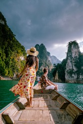 Khao Sok Thailand, couple on vacation in Thailand, men and woman in longtail boat at the Khao Sok national park Thailand
