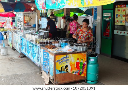 Khao sok, Thailand - March 31, 2018: A Thai women makes a living by cooking fresh street food at a local market.  #1072051391