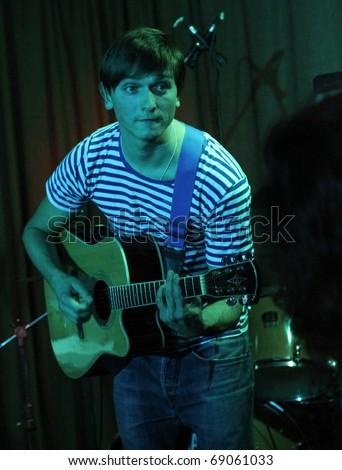 KHARKIV - NOVEMBER 19: Egor Pogrebnyak 45EH band guitarist performs on stage at Jazzter club on November 19, 2010 in Kharkiv, Ukraine