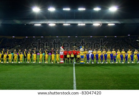 KHARKIV, UA - AUGUST 10: Starting ceremony of Ukraine - Sweden (0:1) national teams friendly football match, August 10, 2011 in Kharkov, Ukraine (Unidentified children and team) - stock photo