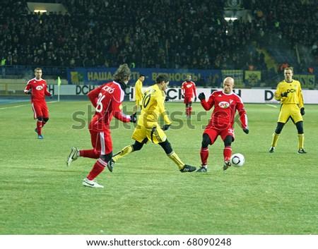 KHARKIV, UA - DECEMBER 1: Metalist Kharkiv MF Cleiton Xavier (C) in action vs. Debrecen during Group stage UEFA Europe League football match (2:1), December 1, 2010 in Kharkov, Ukraine