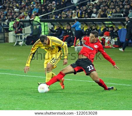 KHARKIV, UA - NOVEMBER 22: Bayer Leverkusen DF Carlinhos (R) in action during UEFA Europa League Group stage (Group K) football match vs. FC Metalist Kharkiv, November 22, 2012 in Kharkiv, Ukraine