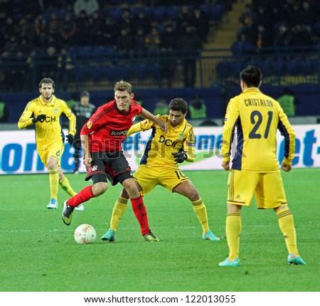 KHARKIV, UA - NOVEMBER 22: Bayer Leverkusen DF Stefan Reinartz (L) in action during UEFA Europa League Group stage football match vs. FC Metalist Kharkiv, November 22, 2012 in Kharkiv, Ukraine