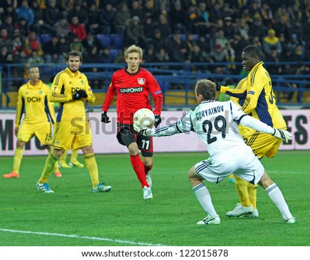 KHARKIV, UA - NOVEMBER 22: FC Metalist Kharkiv GK Oleksandr Horyainov (C) in action during UEFA Europa League Group stage football match vs. Bayer 04 Leverkusen, November 22, 2012 in Kharkiv, Ukraine