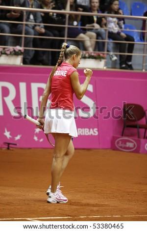 KHARKIV, UKRAINE - APRIL 24: Ukrainian tennis player  Alona Bondarenko during Fed Cup, 2010 World Group Play-Off singles match vs. Australian - Anastasia Rodionova, April 24, 2010 in Kharkiv, Ukraine
