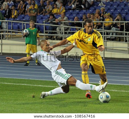 KHARKIV, UKRAINE - AUGUST 26: FC Metalist Kharkiv DF Fininho (R) in action during Europa League Qualifying football match vs Athletic Club Omonia Nicosia, August 26, 2010 in Kharkov, Ukraine