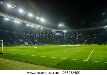 KHARKIV, UKRAINE - FEBRUARY 21, 2018: Empty stadium before the start UEFA Champions League Round of 16 game against Shakhtar Donetsk at OSK Metalist stadium in Kharkiv, Ukraine #1033982455