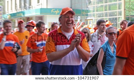 KHARKIV, UKRAINE - JUNE 9: Netherlands fans at Kharkov streets before UEFA EURO 2012 football match vs. Denmark national team, June 9, 2012 in Kharkiv, Ukraine